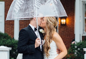 Couple Standing in the Rain on Wedding Day
