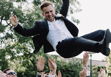 Groom Being Throw In The Air By Groomsmen